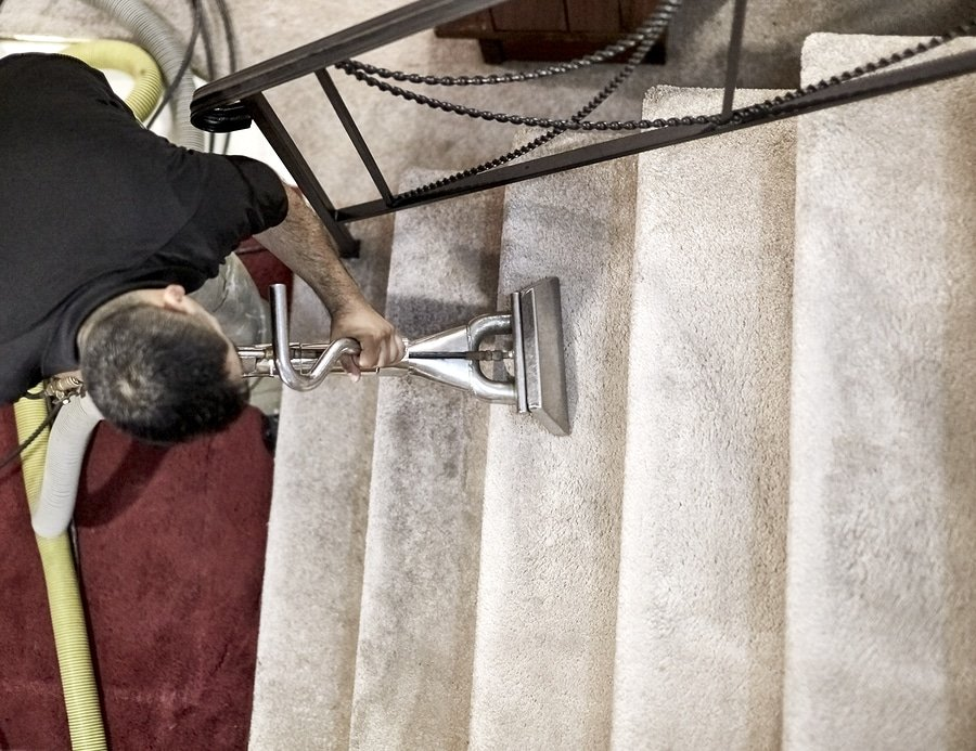 Professional carpet cleaner cleaning the steps in a home