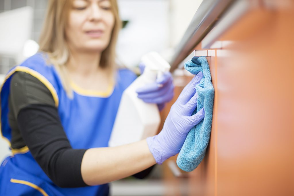 Woman at work professional maid cleaning at school