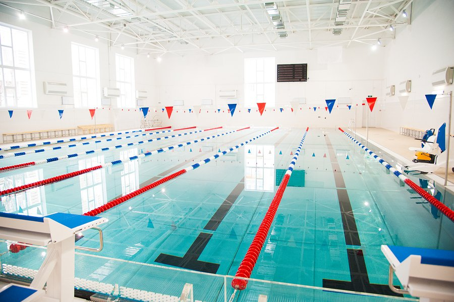 interior of public swimming pool. Lanes of a competition swimming pool