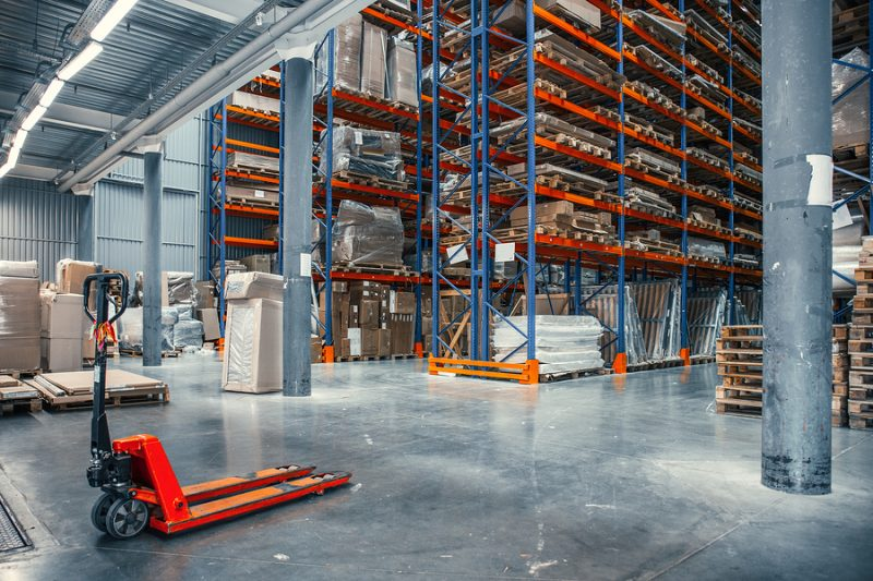 Large Logistics hangar warehouse with lots shelves or racks with pallets of goods. Industrial shipping and cargo delivery distribution concept